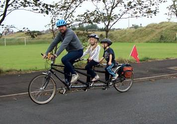 Family triplet bicycle in use